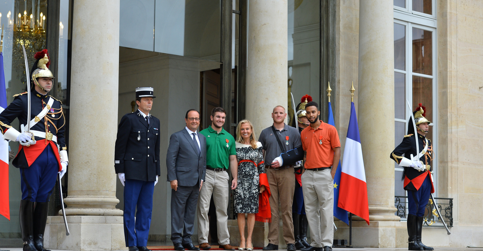 French President Francois Hollande (L) poses with Americans Alek Skarlatos (2nd L), Spencer Stone (2nd R) and Anthony Sandler (L), and US ambassador to France Jane D. Hartley (C) after a ceremony in their honor at the Elysee Palace, in Paris, France on August 24, 2015. The three American friends and British man Chris Norman have been awarded the Legion of Honor medal for bravery. They prevented a massacre aboard a Thalys high-speed train en route to Paris from Amsterdam on Friday when a heavily armed Moroccan gunman known as Ayoub El Khazzani opened fire. Photo by Christian Liewig/Sipa USA